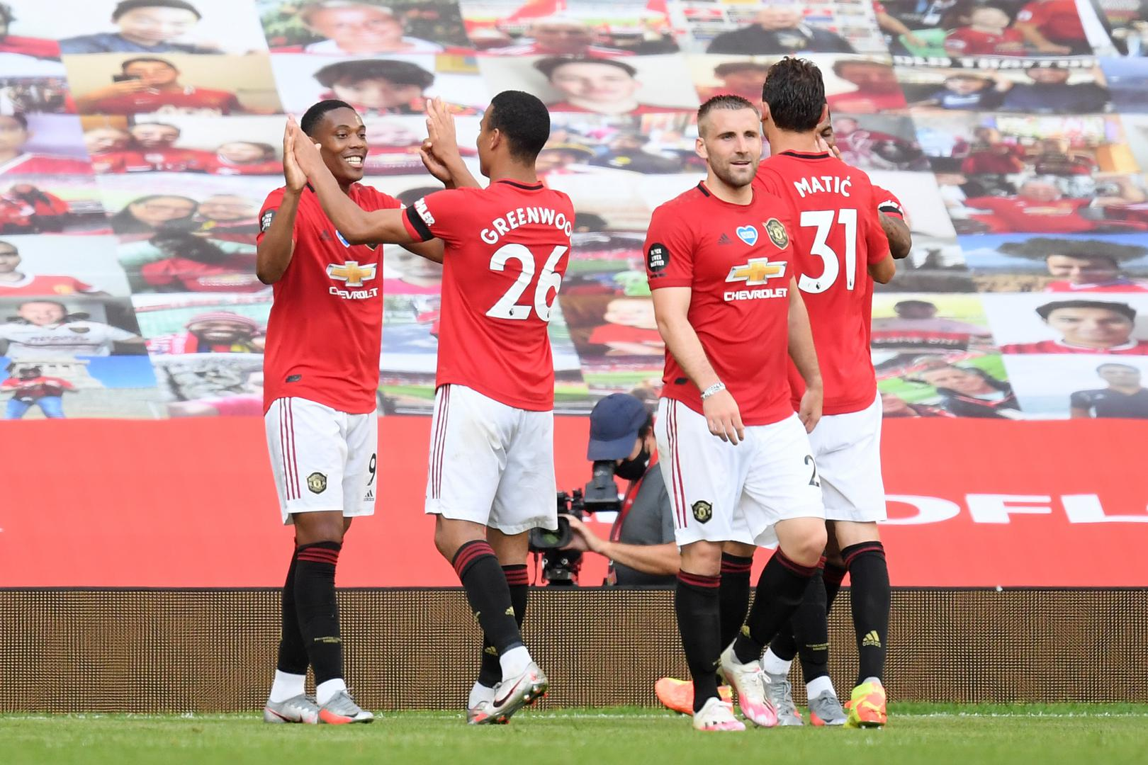 Anthony Martial celebrates with his Manchester United team-mates after completing his hat-trick against Sheffield United