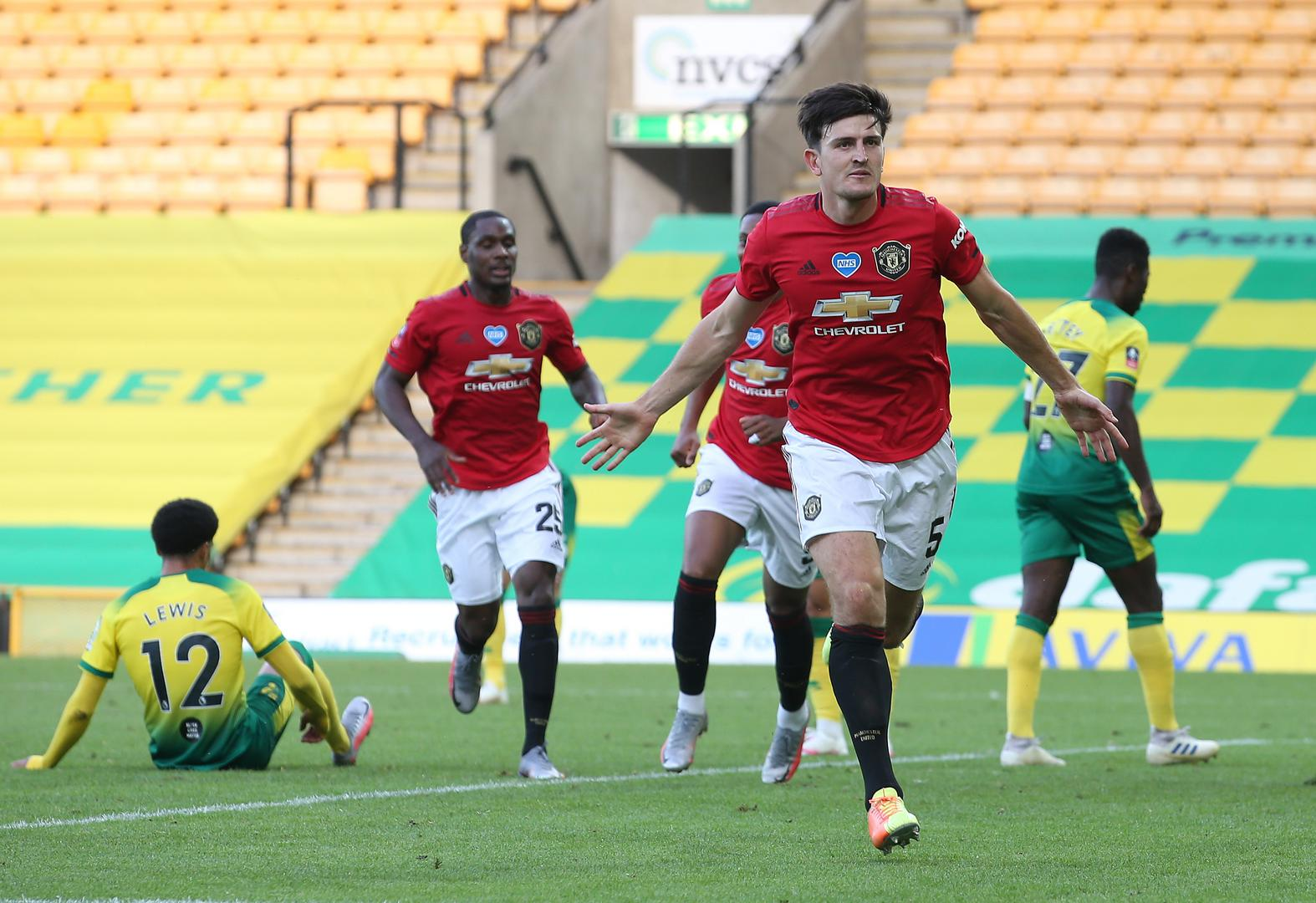 Harry Maguire celebrates scoring against Norwich City.