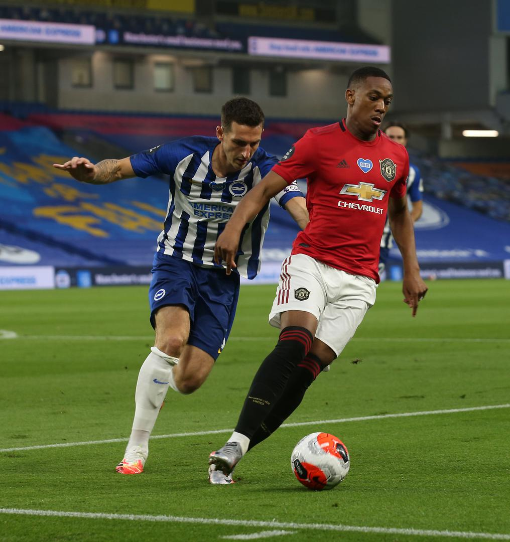 Anthony Martial comes under pressure from Brighton defender Lewis Dunk.
