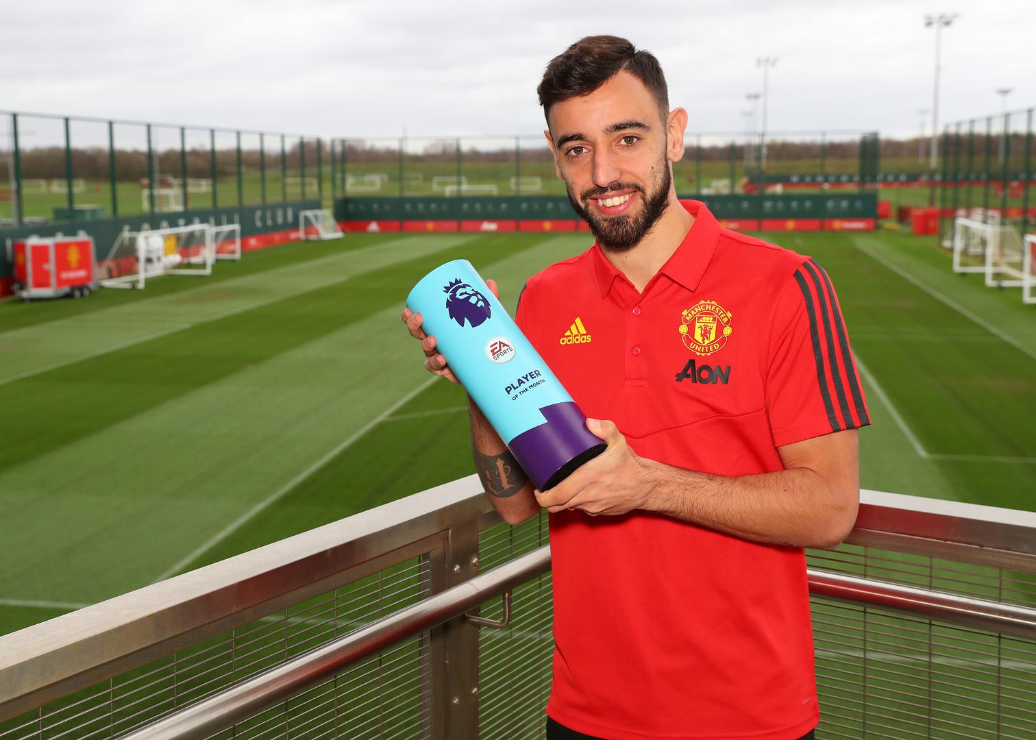 Bruno Fernandes with his February Player of the Month award,