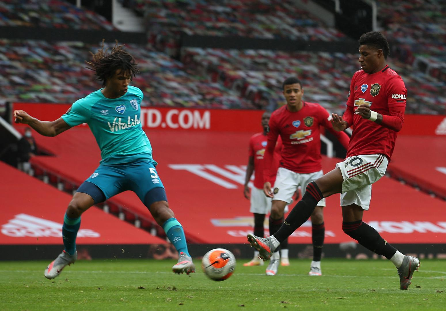 Marcus Rashford in action with Nathan Ake and Mason Greenwood.,