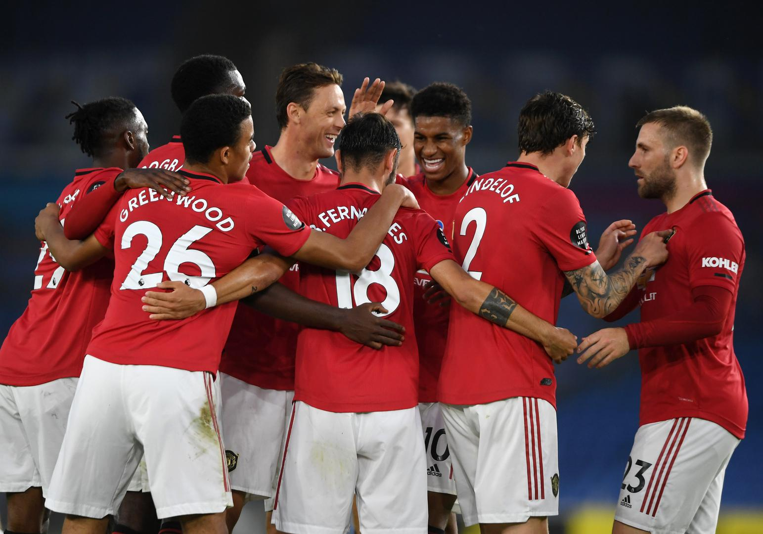 Manchester United players including Nemanja Matic, Bruno Fernandes and Marcus Rashford celebrate a goal.