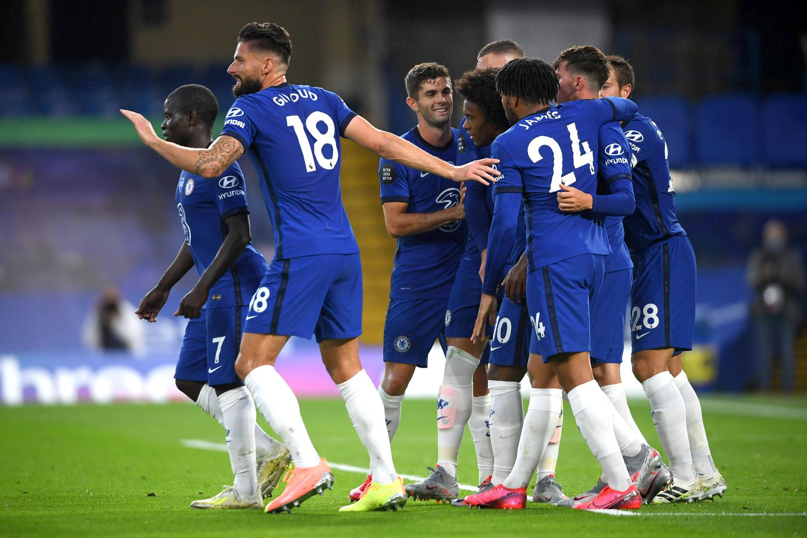 Chelsea players celebrate a goal.