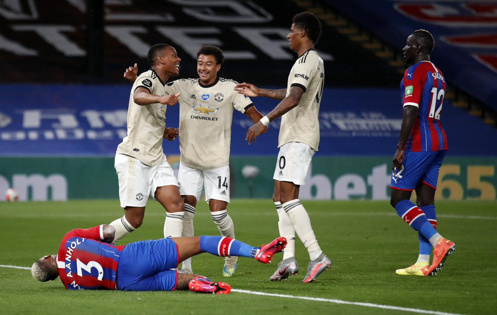 Anthony Martial, Jesse Lingard and Marcus Rashford celebrate Manchester United's second goal against Crystal Palace at Selhurst Park