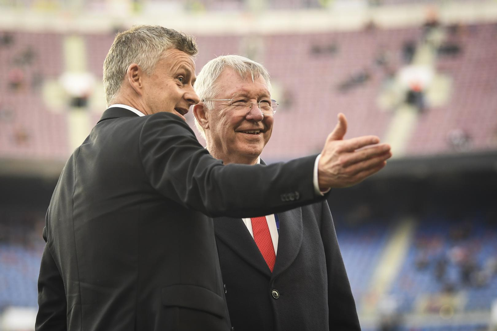 Ole Gunnar Solskjaer and Sir Alex Ferguson.,