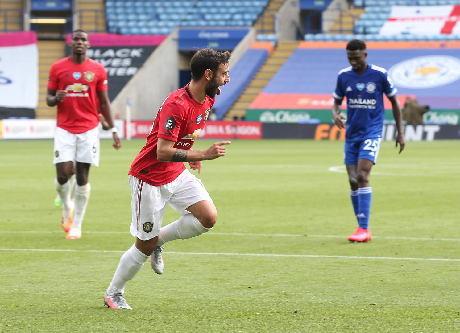 Bruno Fernandes celebrates scoring for Manchester United.,