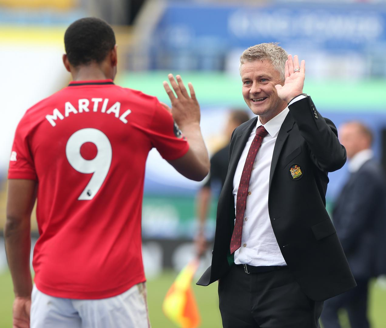 Ole Gunnar Solskjaer high-fives Anthony Martial..