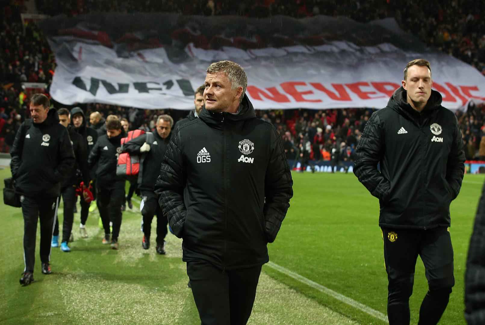 Ole Gunnar Solskjaer walks to his place in the dug-out.,