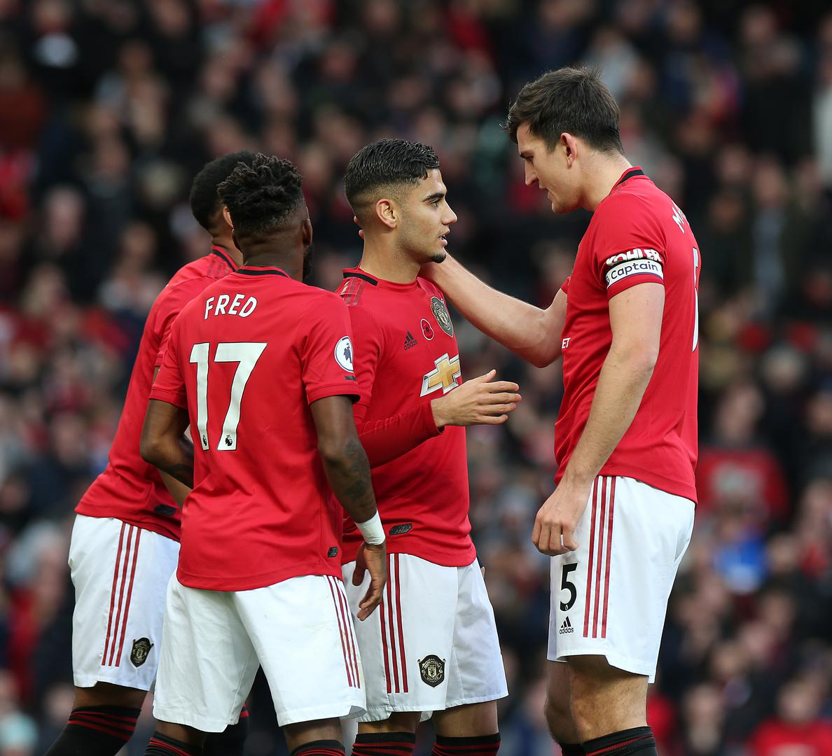 Harry Maguire embraces Andreas Pereira after his goal against Brighton