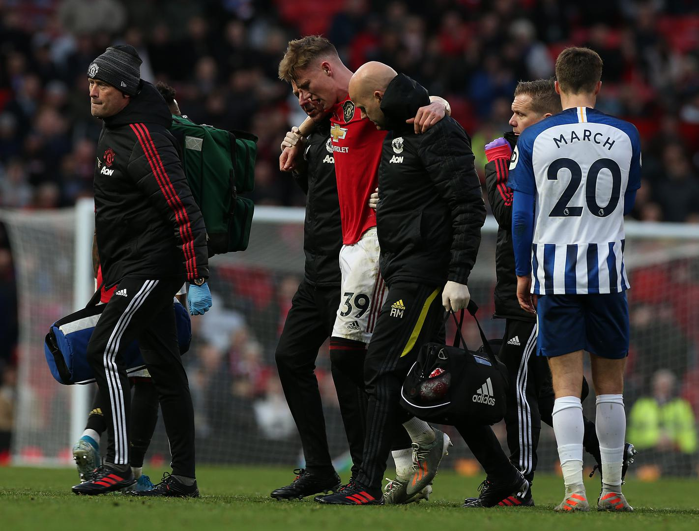 Scott McTominay is helped off against Brighton.