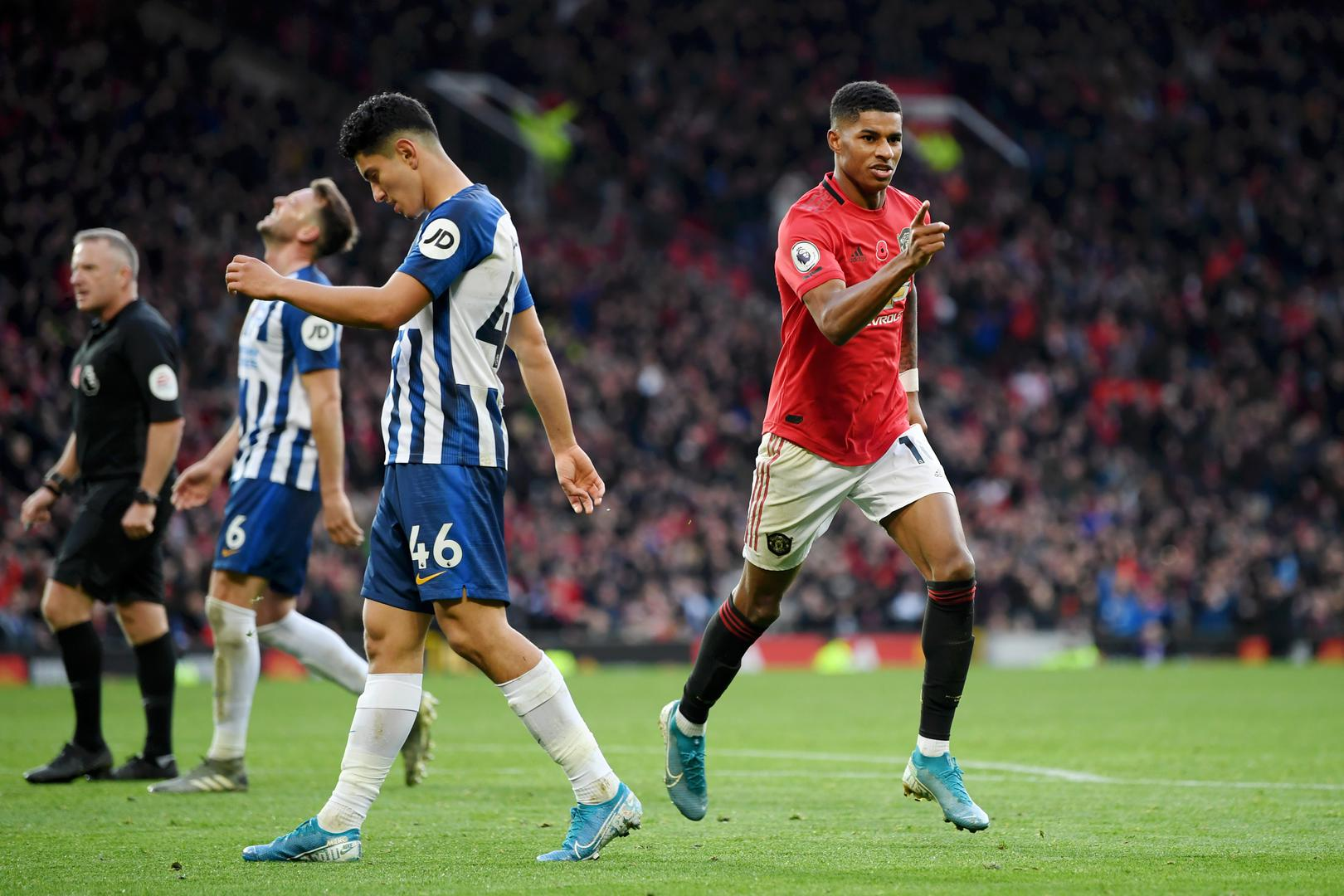Marcus Rashford celebrates after scoring Manchester United's third goal against Brighton