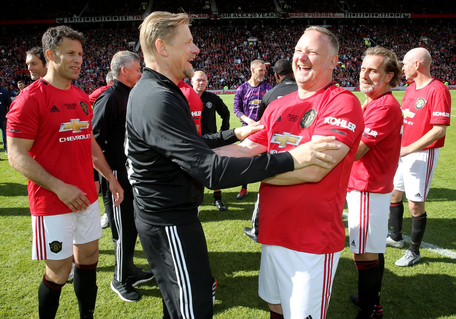 David May with Peter Schmeichel