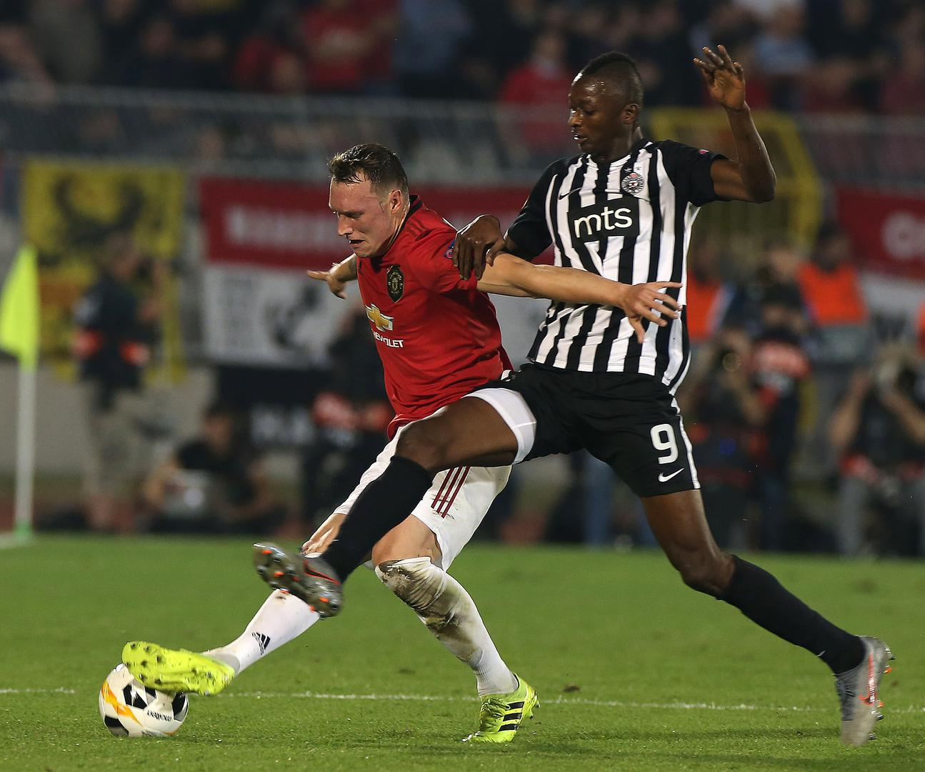 Phil Jones battles for the ball with Partizan's Umar Sadiq.