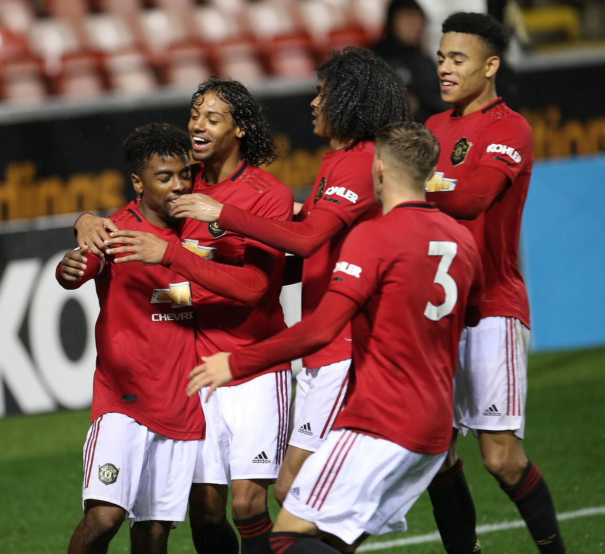 Angel Gomes is mobbed after scoring.