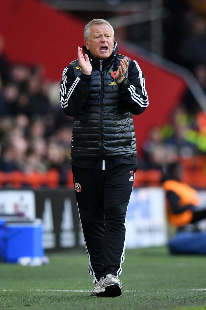 Chris Wilder gives instructions from the sidelines during a Sheffield United game.
