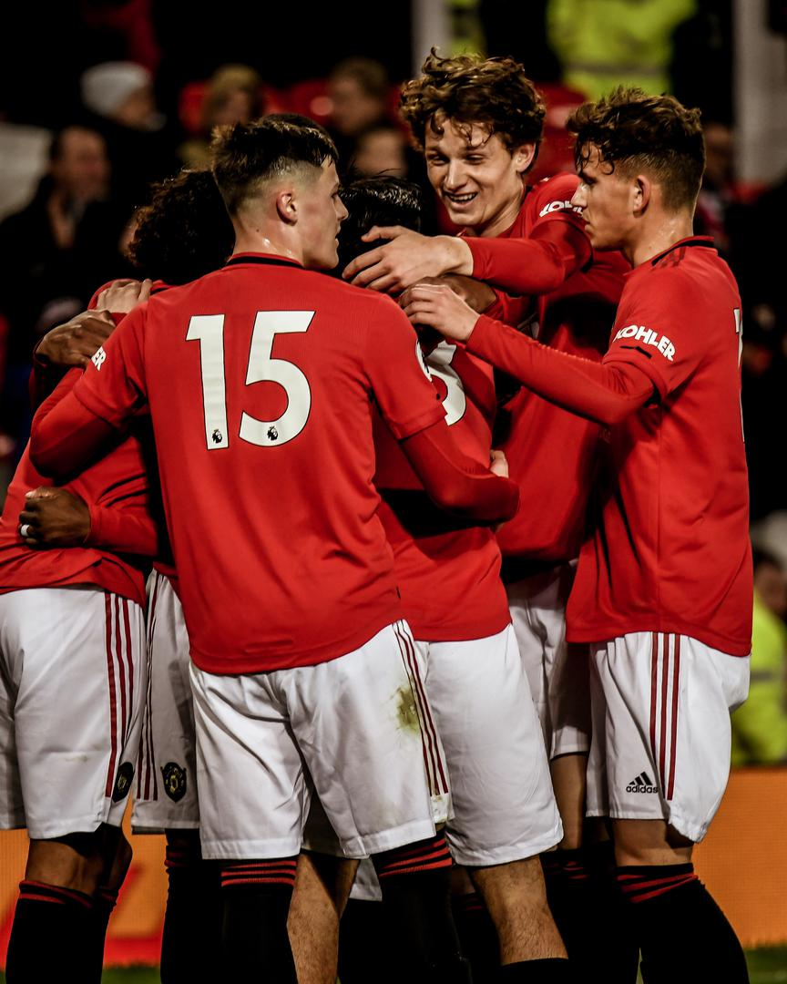 United celebrate the third goal.
