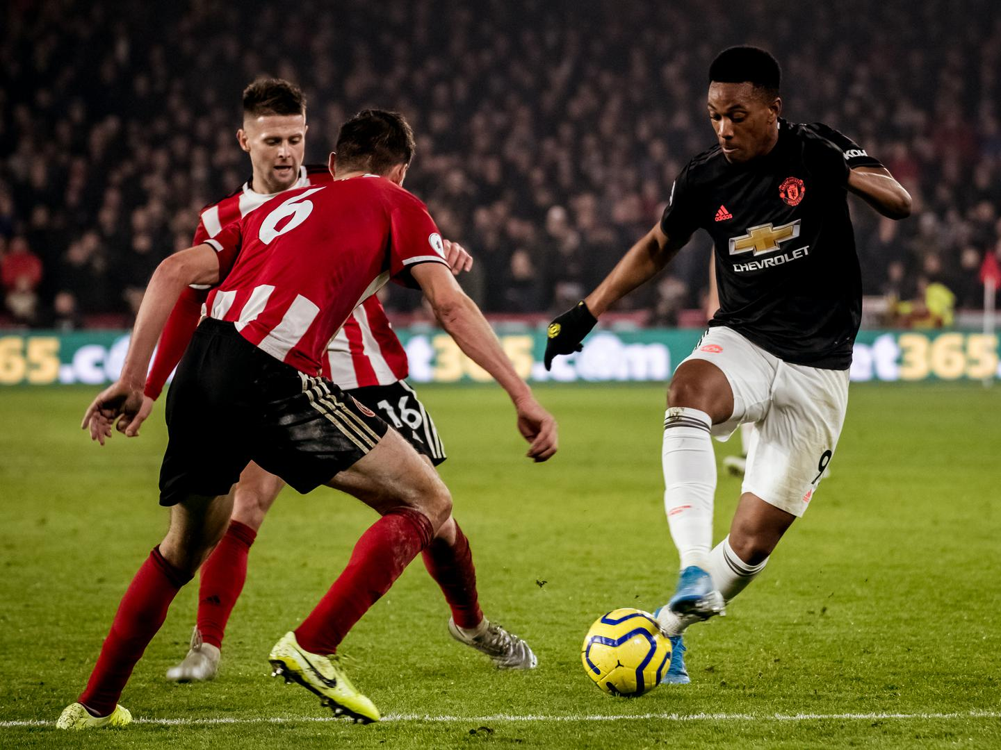 Anthony Martial takes on the Sheffield United defence