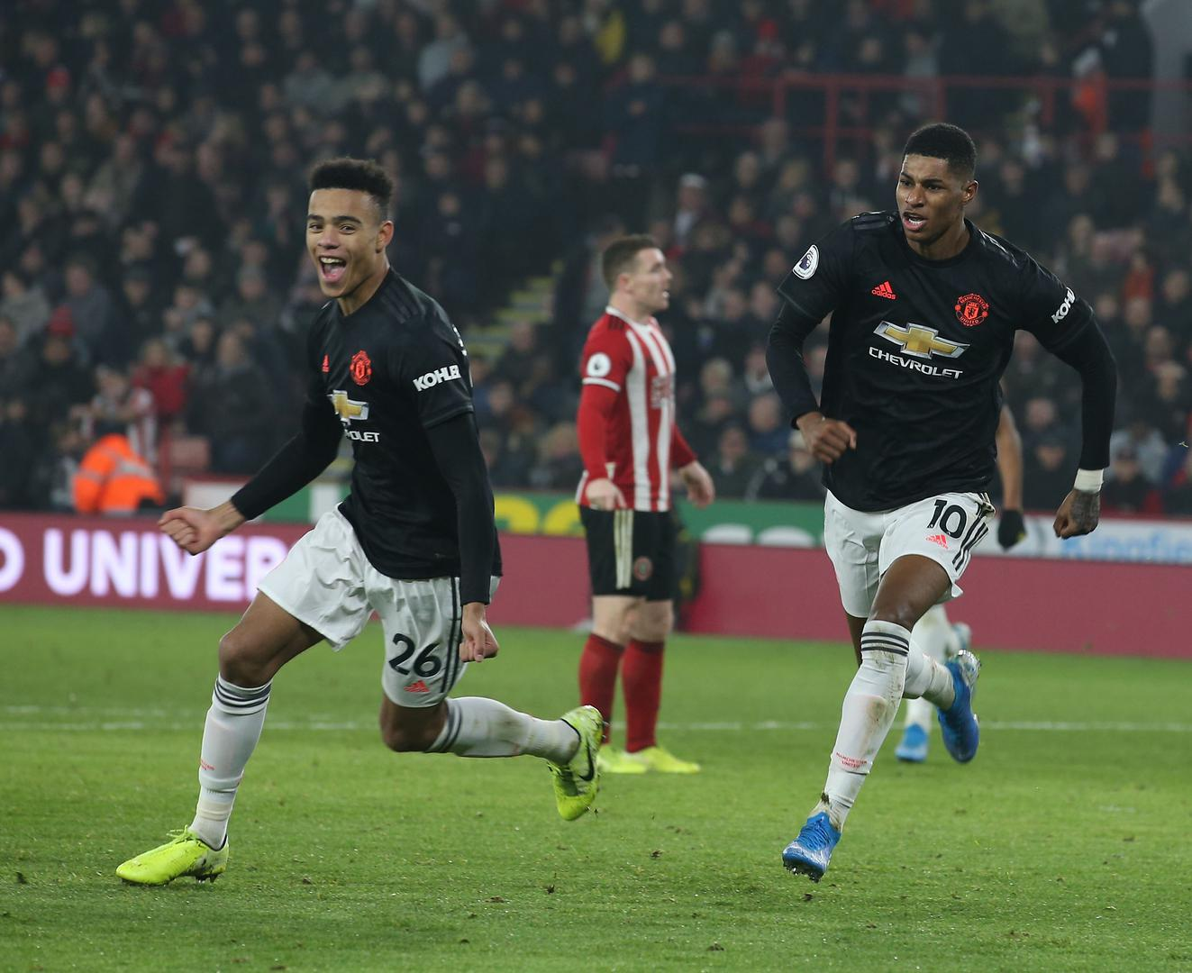 Mason Greenwood and Marcus Rashford celebrate scoring a goal for Manchester United..