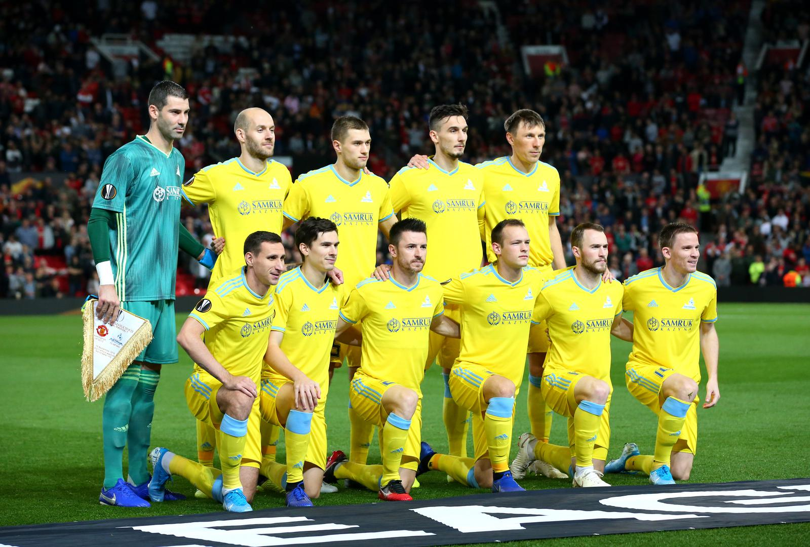 Astana line up for a team photograph at Old Trafford