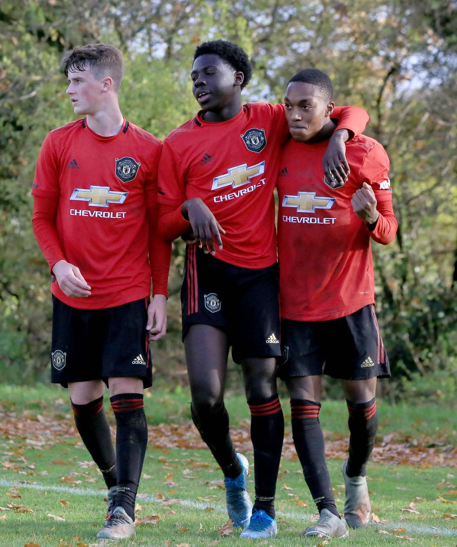 Manchester United Under-18 players celebrate the winning goal against West Brom in the Premier League Cup