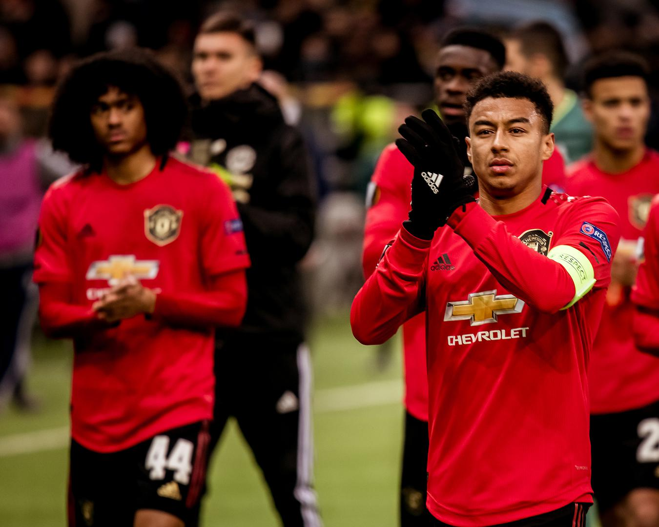 Jesse Lingard applauds the crowd