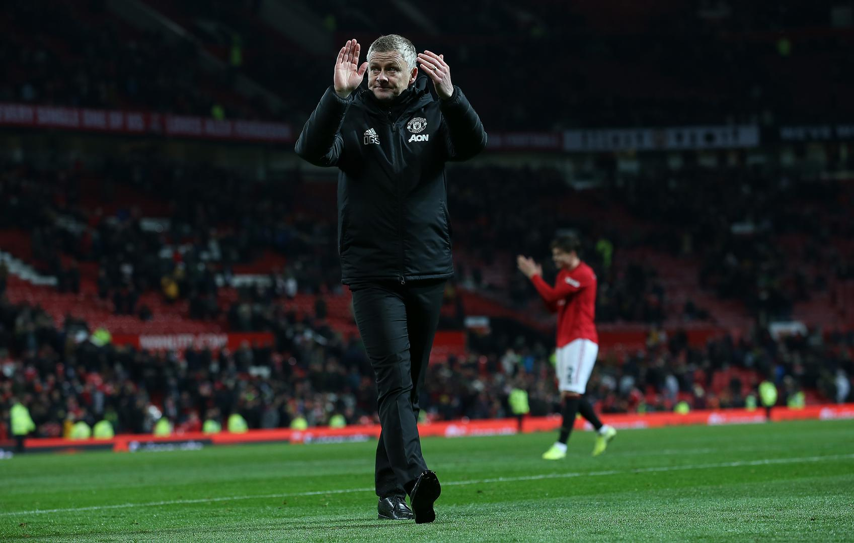 Ole Gunnar Solskjaer applauds the Stretford End after the game.