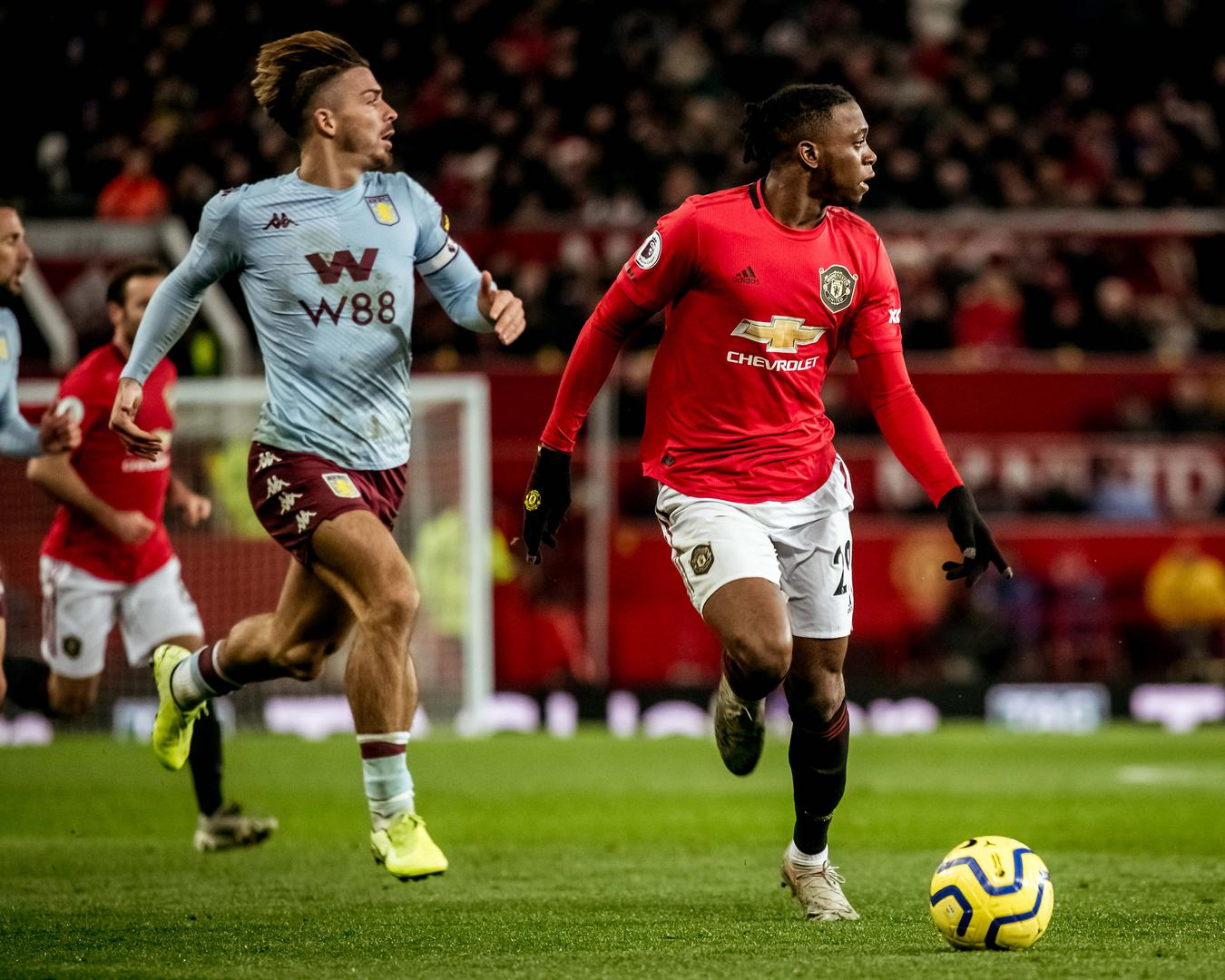 Aston Villa's Jack Grealish and Manchester United's Aaron Wan-Bissaka