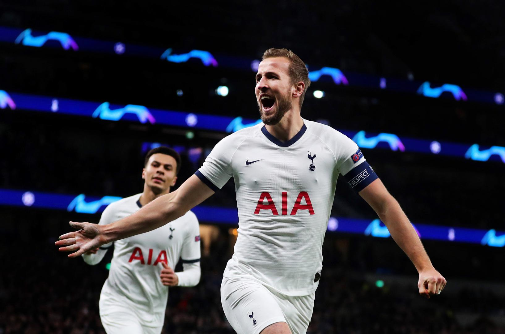 Harry Kane runs away in celebration after scoring for Tottenham