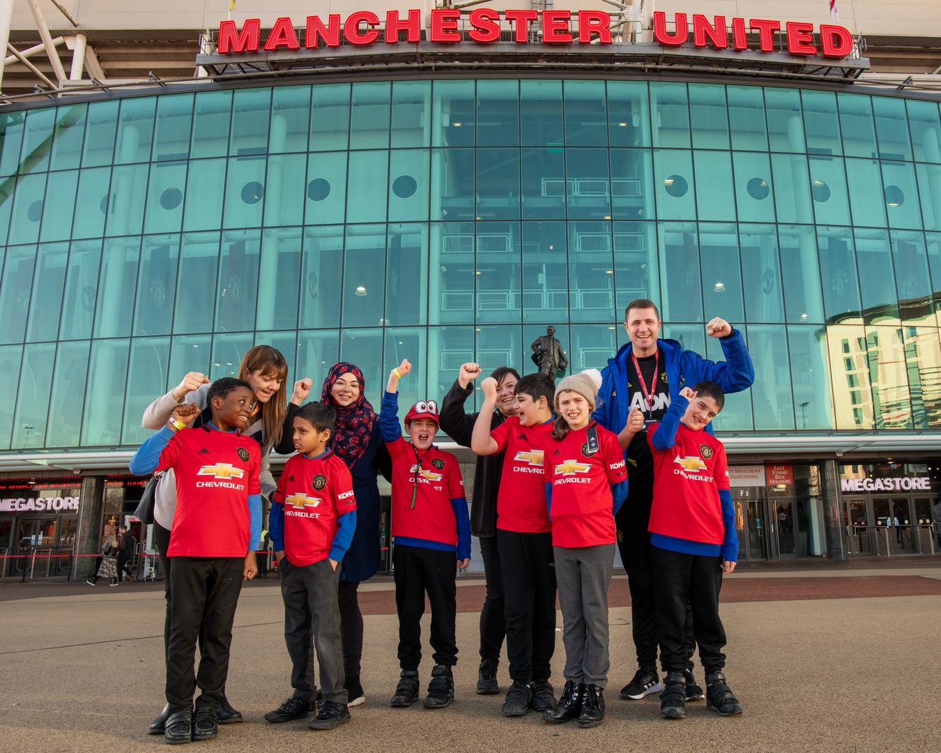 Fans standing outside the club Megastore.