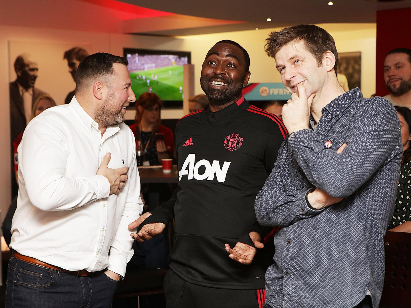 Manchester United legend Andy Cole meets members of the Rainbow Devils group