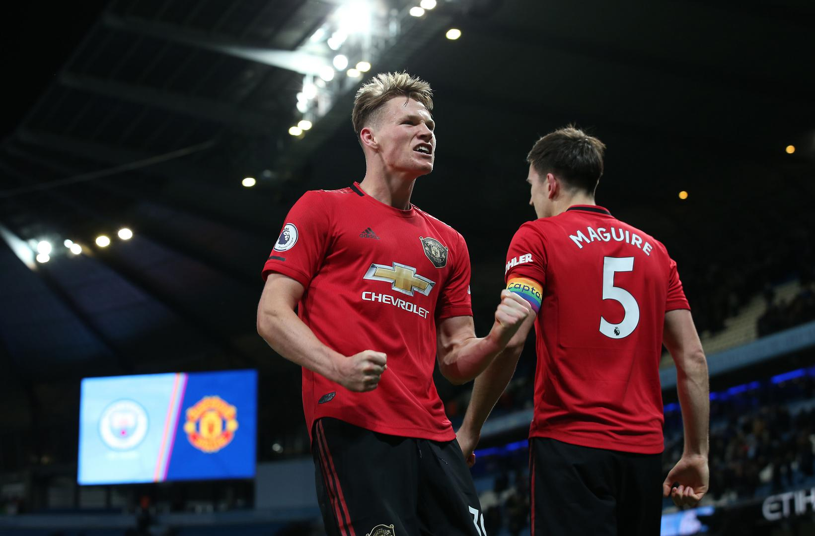 Scott McTominay and Harry Maguire celebrate winning the Manchester derby.