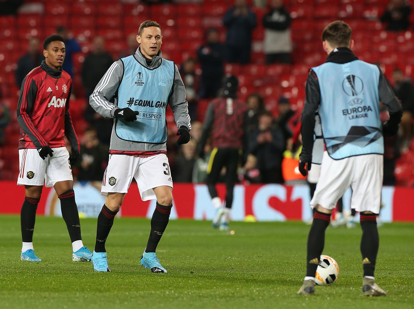 Anthony Martial, Nemanja Matic and James Garner warm-up ahead of a Europa League match.