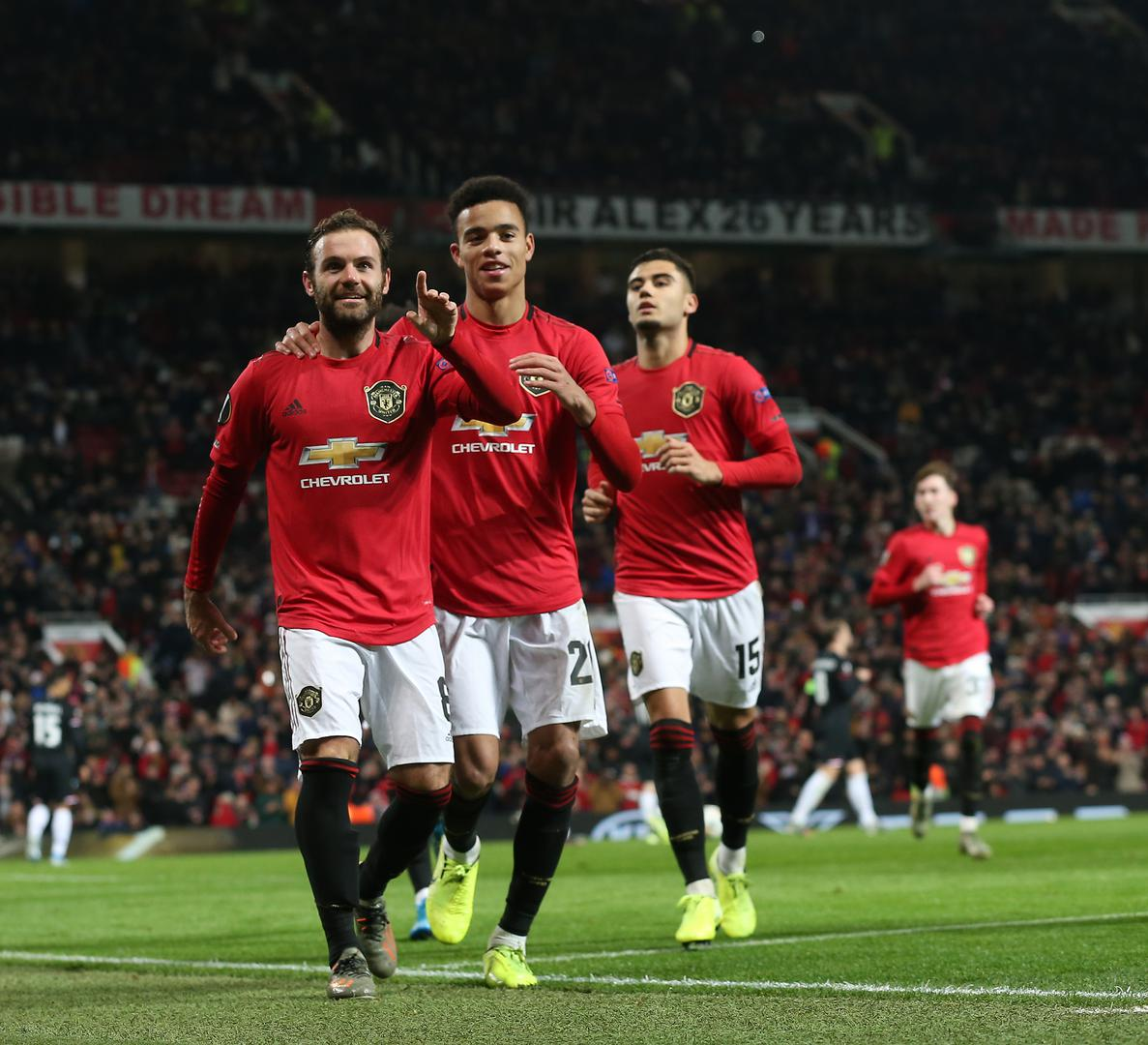 Manchester United players celebrate scoring against AZ Alkmaar.