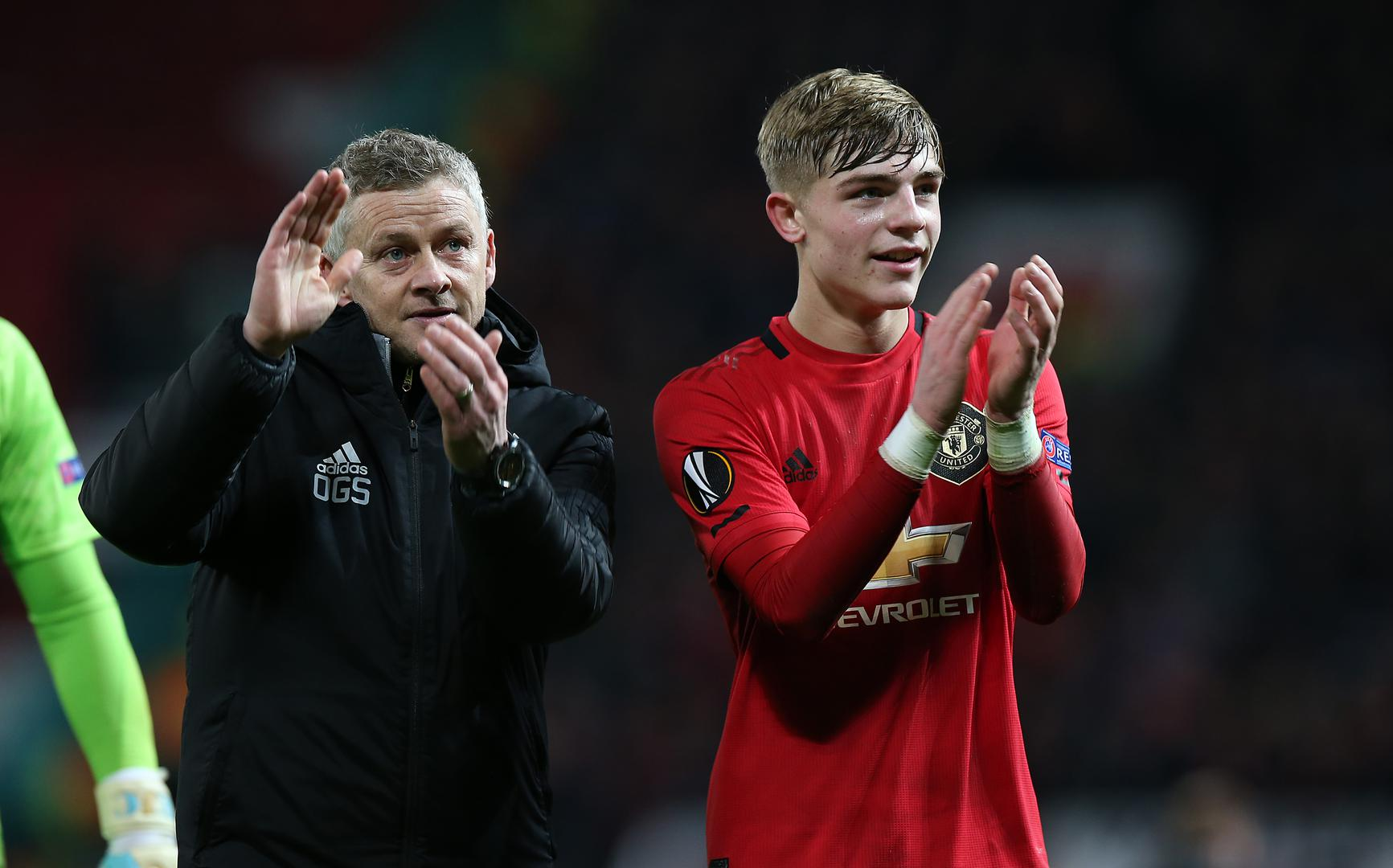 Ole Gunnar Solskjaer and Brandon Williams applaud supporters after United beat Alkmaar 4-0.,