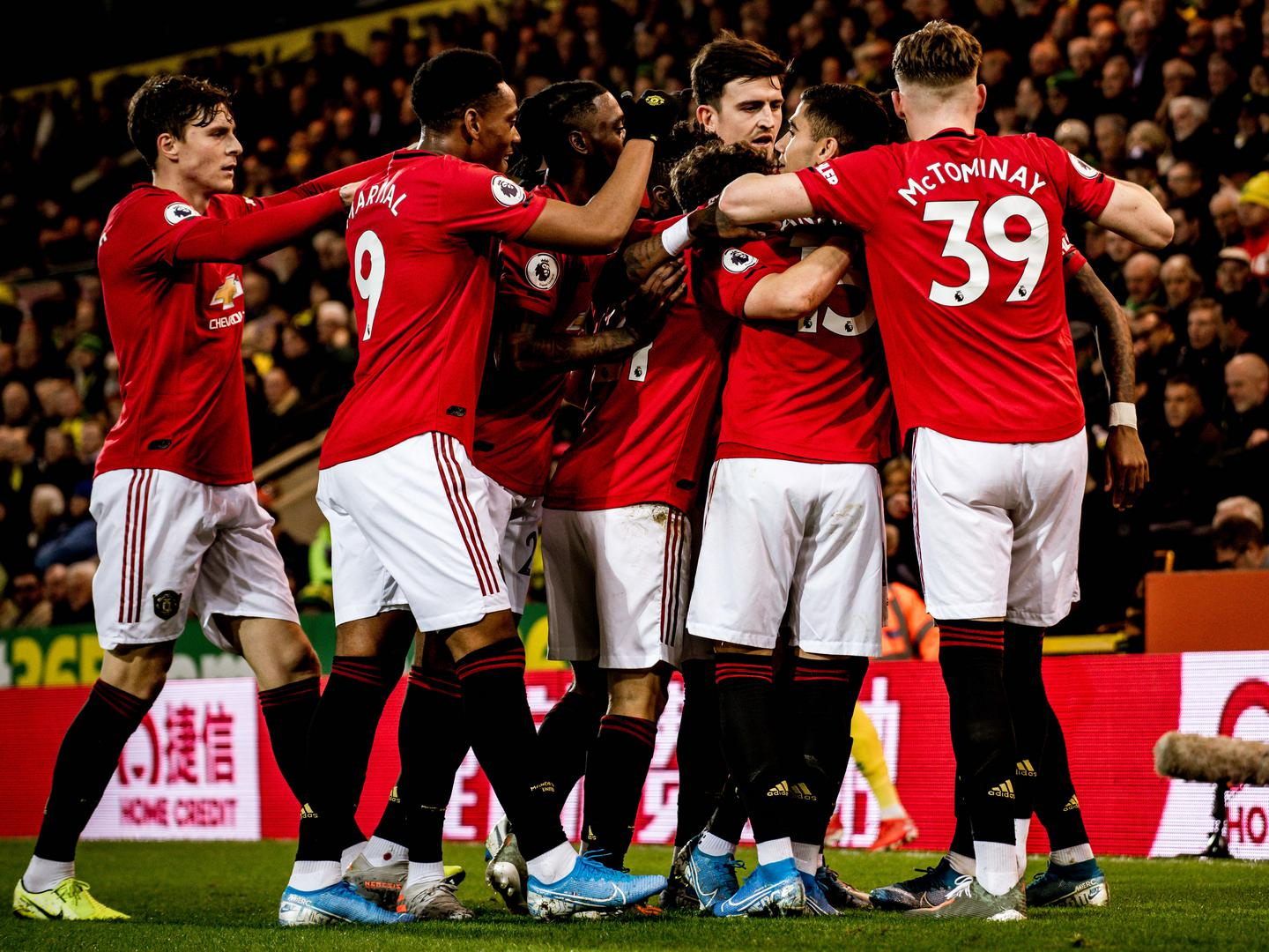 Manchester United players celebrate a goal against Norwich City