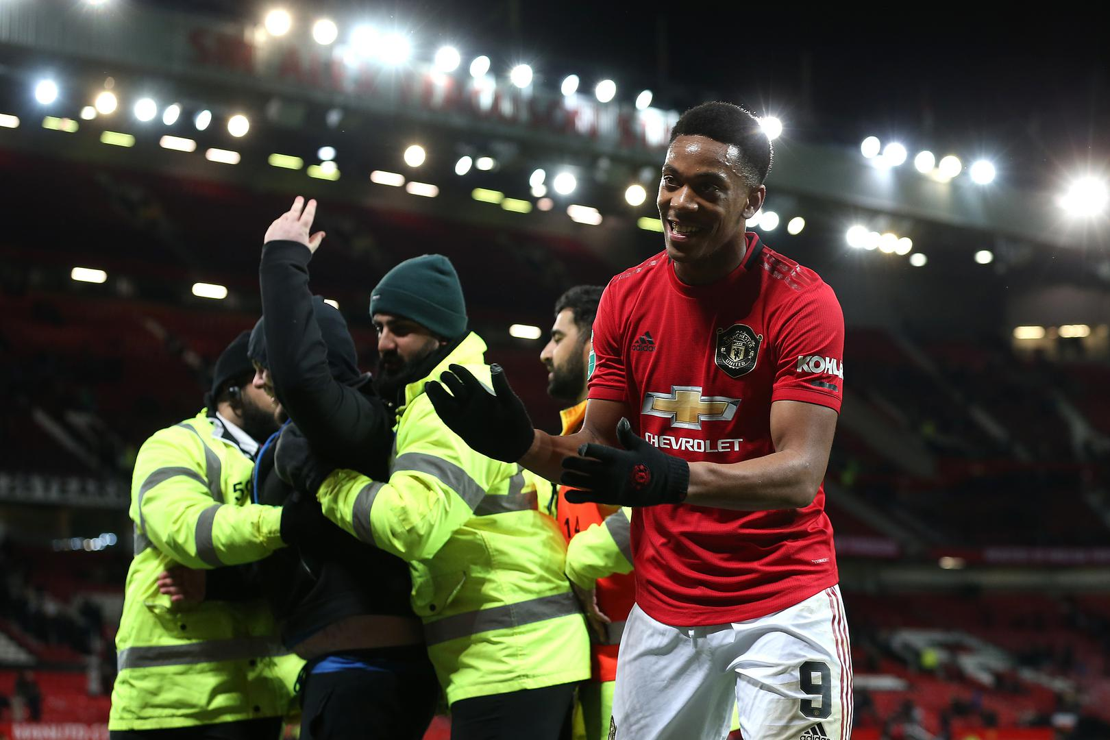 Anthony Martial applauds the fans.