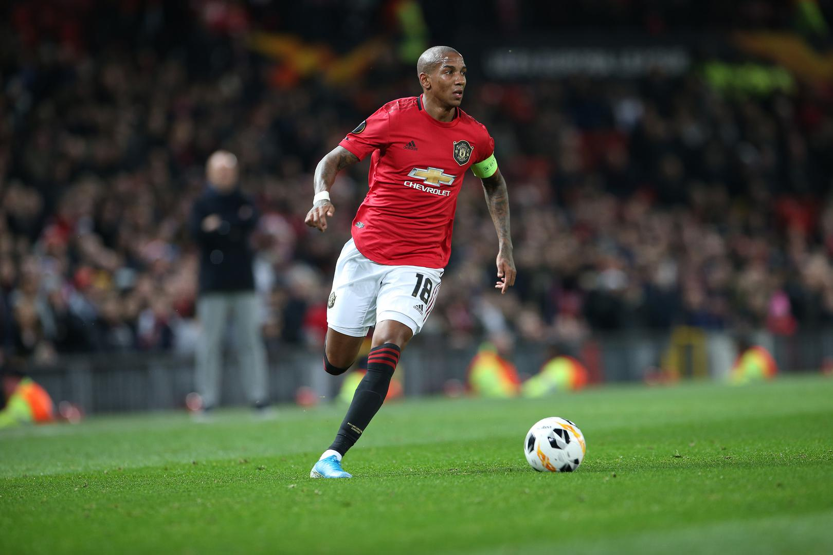 Ashley Young wearing the armband.