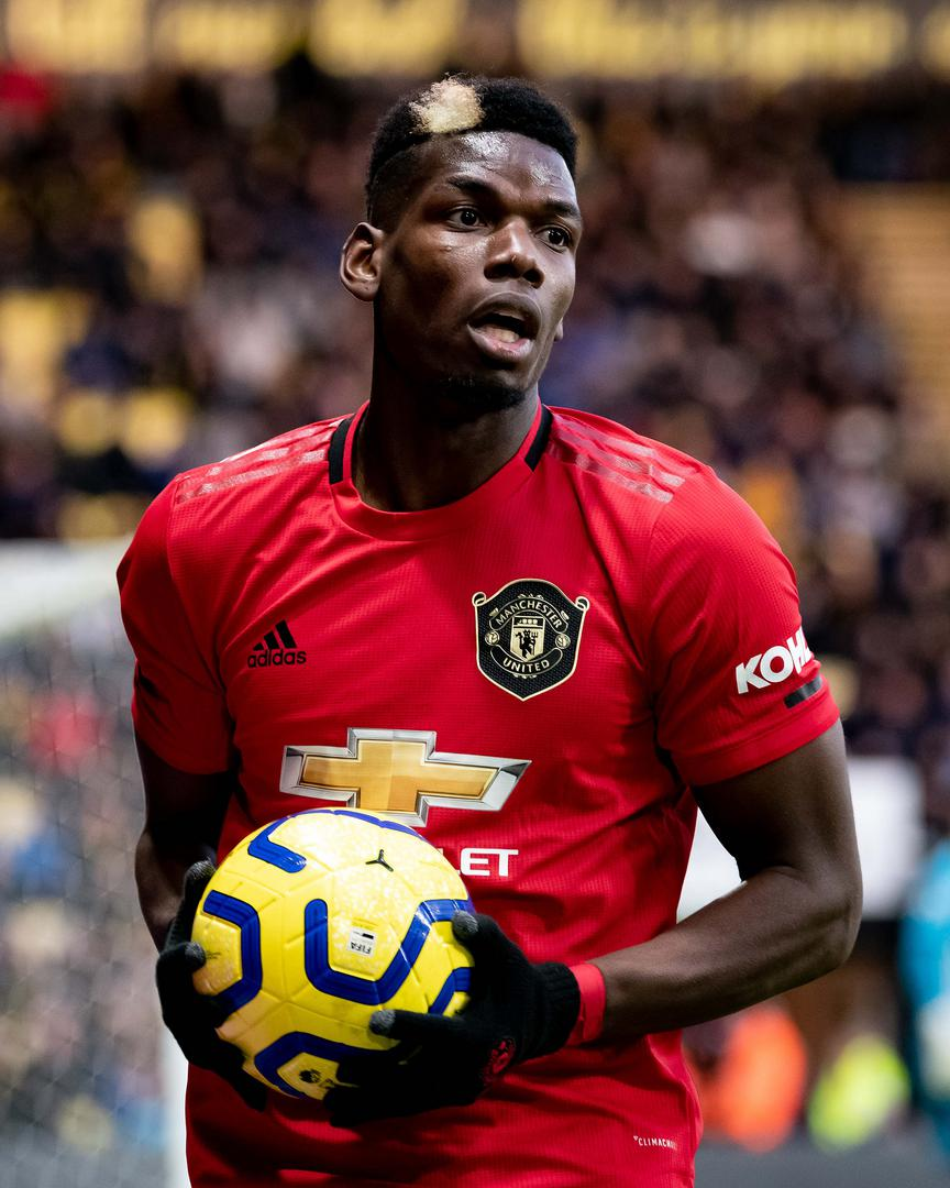 Paul Pogba holds the ball at Watford