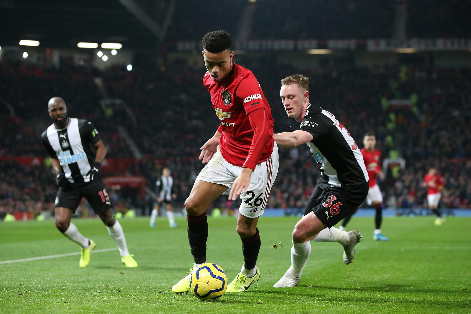 Mason Greenwood shields the ball.