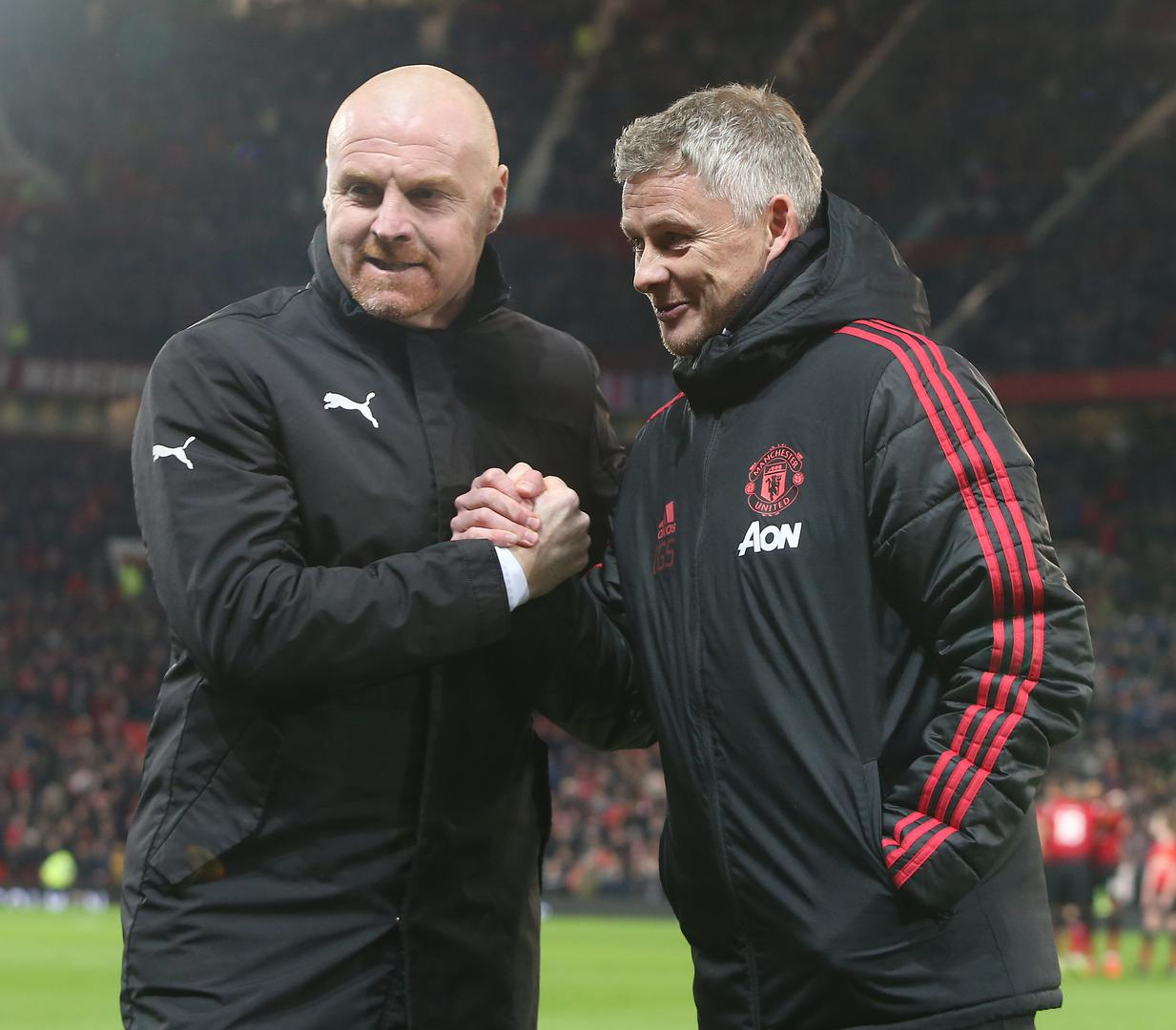 Burnley manager Sean Dyche greets Manchester United boss Ole Gunnar Solskjaer at Old Trafford.