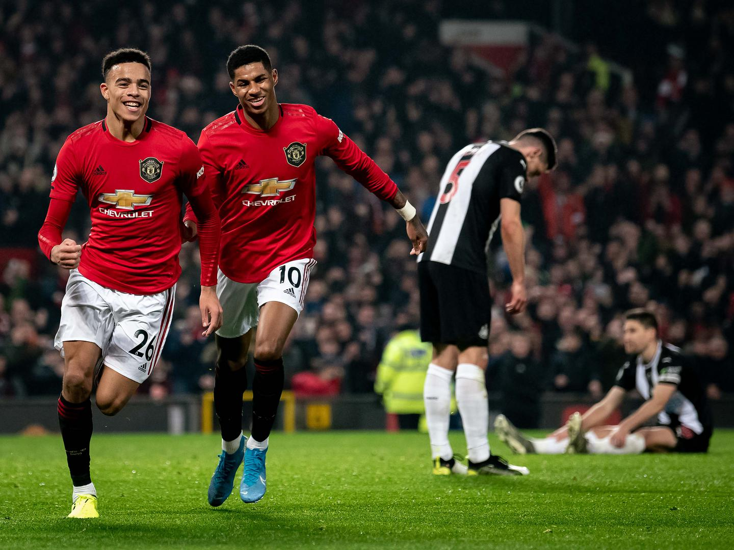 Mason Greenwood and Marcus Rashford run away in celebration