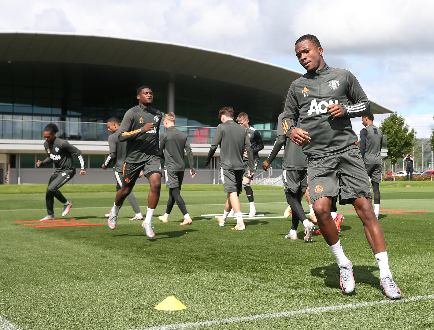 Ethan Laird and the United players in training.,