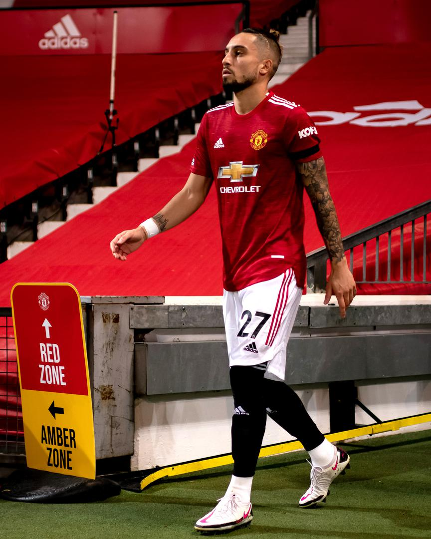 Alex Telles walking out at Old Trafford.,