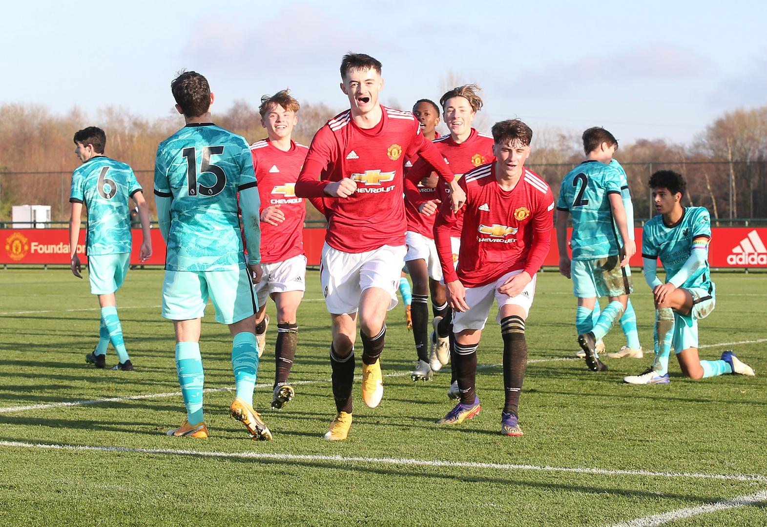 Joe Hugill celebrates one of his two goals against Liverpool Under-18s