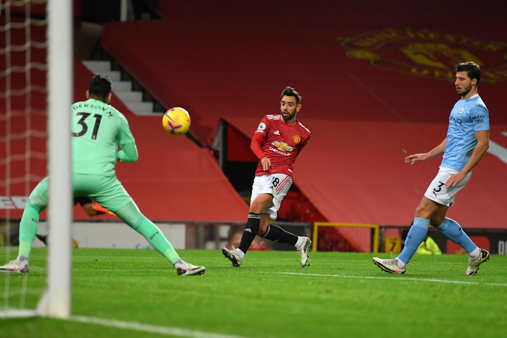 Bruno Fernandes shoots on target against Manchester City in the Premier League at Old Trafford