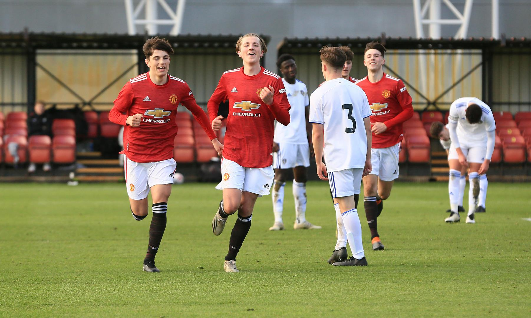 Charlie Savage and his Manchester United Under-18 team-mates celebrate a goal