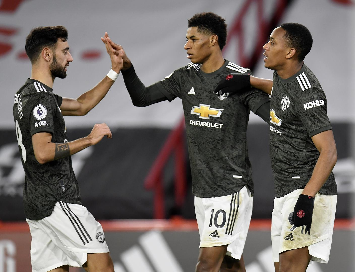 Bruno Fernandes, Marcus Rashford and Anthony Martial celebrate.