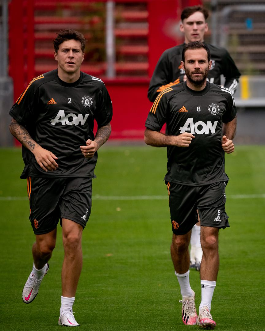Victor Lindelof and Juan Mata..
