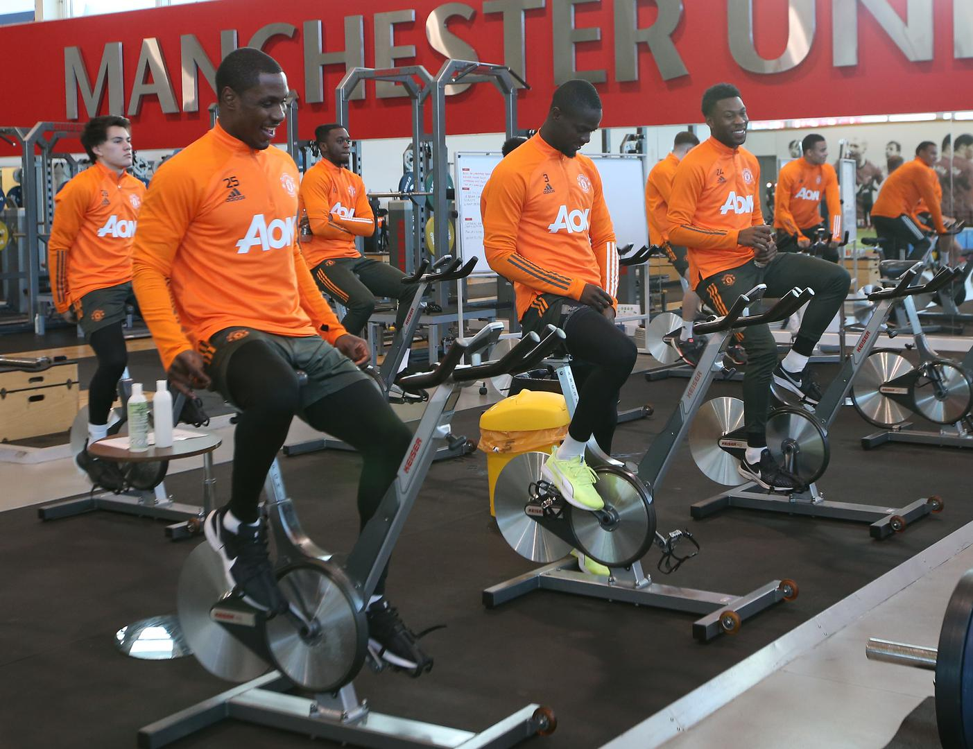 Manchester United players on exercise bikes.,