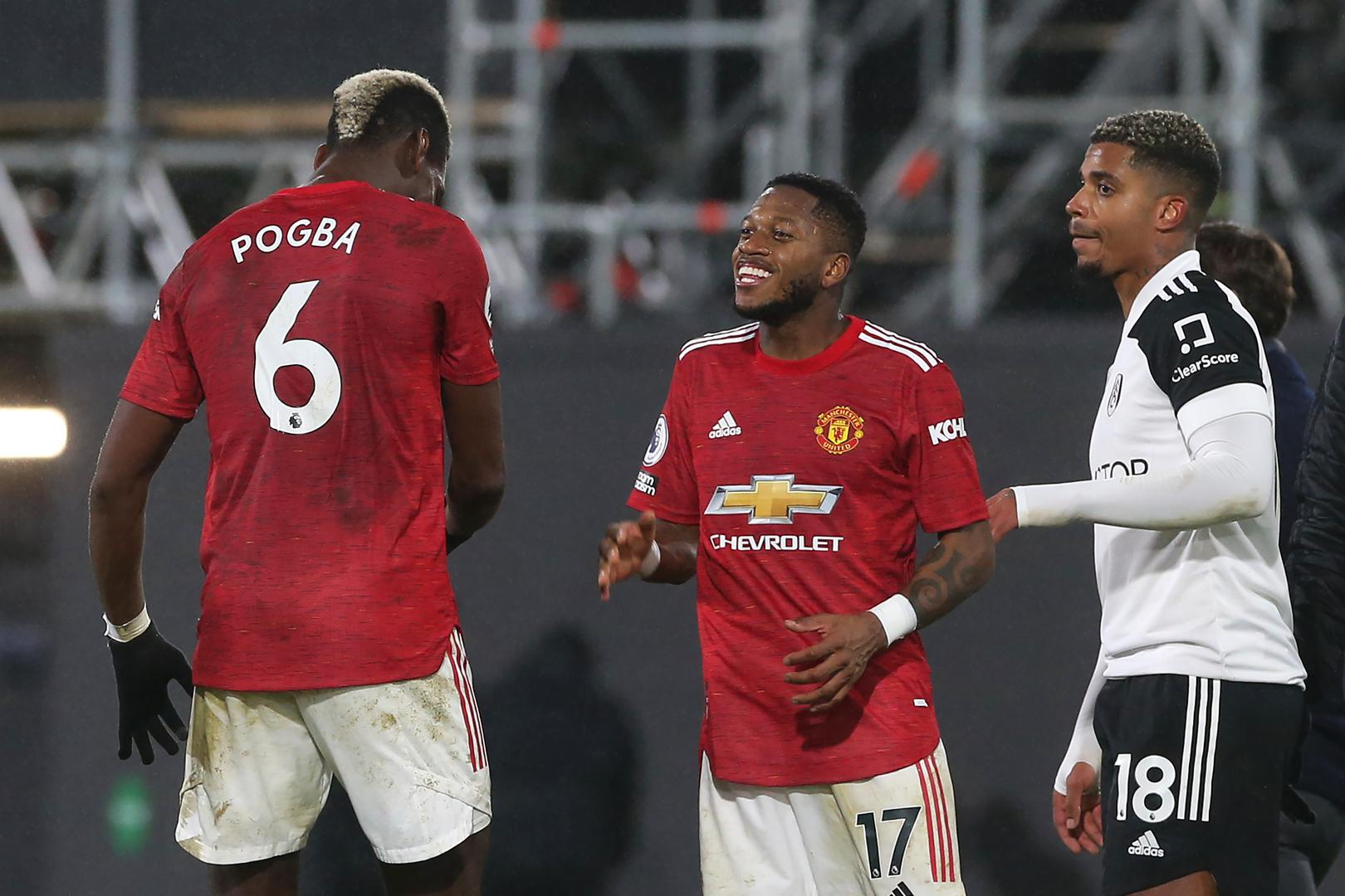 Paul Pogba and Fred celebrate at Fulham